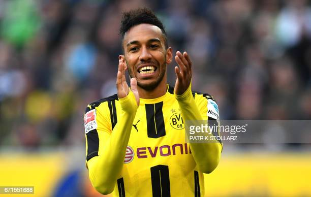 Dortmund's Gabonese striker PierreEmerick Aubameyang celebrate after scoring during the German first division Bundesliga football match Borussia...