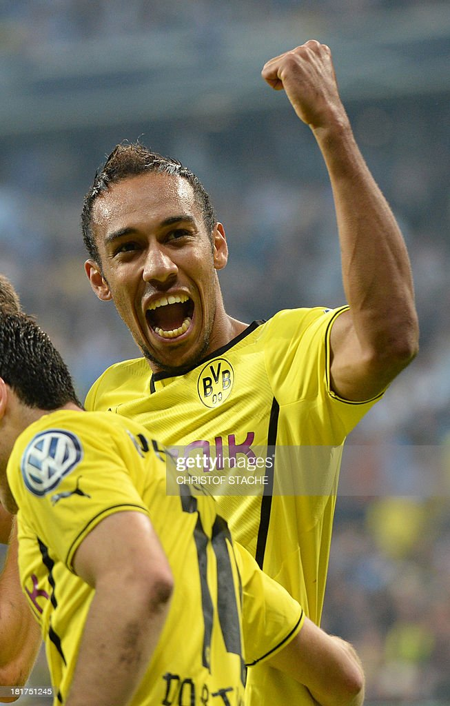 Dortmund's Gabonese striker Pierre-Emerick Aubameyang celebrates after the second goal during the second round football match of the German Cup (DFB - Pokal) TSV 1860 Munich vs Borussia Dortmund on September 24, 2013 in Munich, southern Germany. DURING THE MATCH AND PROHIBITS MOBILE (MMS) USE