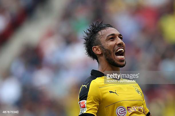 Dortmund's Gabonese striker PierreEmerick Aubameyang celebrates after scoring his team's fourth goal during the German first division Bundesliga...