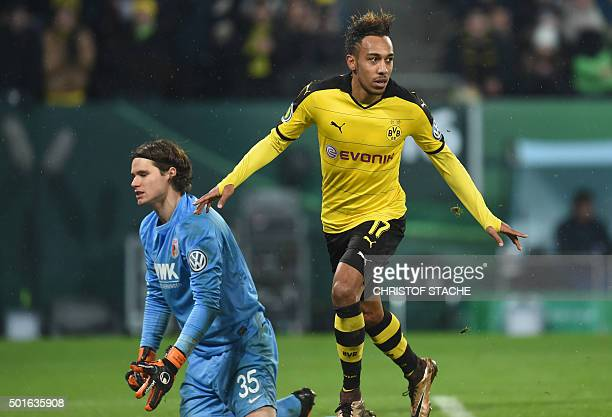 Dortmund's Gabonese striker PierreEmerick Aubameyang celebrates after his goal beside Augsburg's Swiss goalkeeper Marwin Hitz during the German Cup...