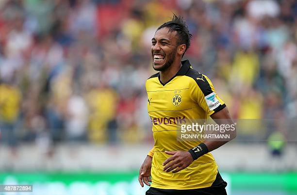Dortmund's Gabonese striker PierreEmerick Aubameyang celebrates his team's third goal during the German first division Bundesliga football match...