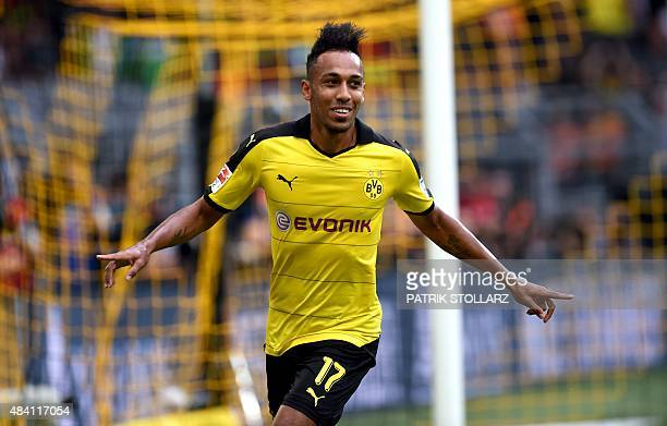 Dortmund's Gabonese striker PierreEmerick Aubameyang celebrates scoring during the German first division Bundesliga football match Borussia Dortmund...