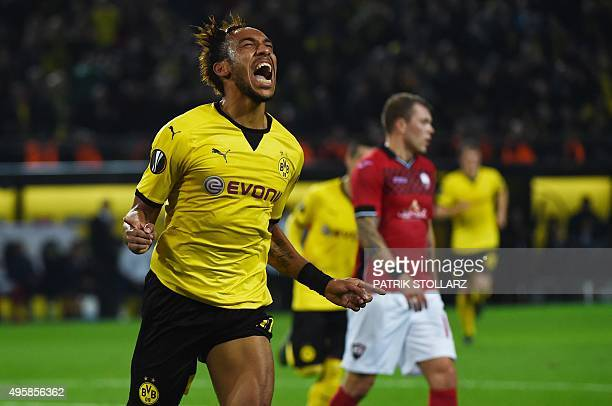 Dortmund's Gabonese striker PierreEmerick Aubameyang celebrates scoring during the UEFA Europa League football match Borussia Dortmund vs Qabala FK...