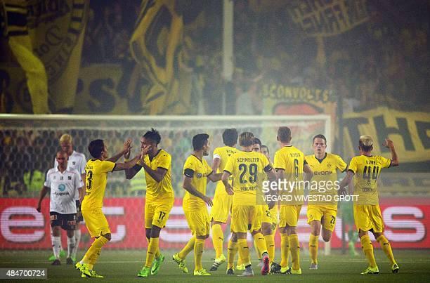 Dortmund's Gabonese striker PierreEmerick Aubameyang celebrates scoring with teammate Dortmund's Japanese midfielder Shinji Kagawa during the UEFA...