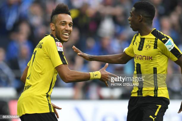 Dortmund's Gabonese striker PierreEmerick Aubameyang celebrates with his teammate French midfielder Ousmane Dembele after scoring the 01 during the...