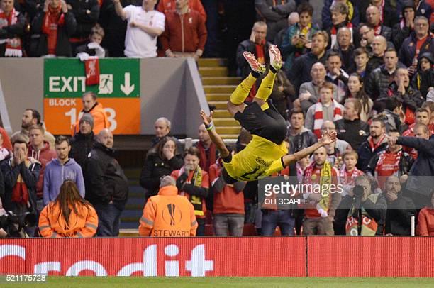 TOPSHOT Dortmund's Gabonese striker PierreEmerick Aubameyang does a somersault after scoring during the UEFA Europa league quarterfinal second leg...