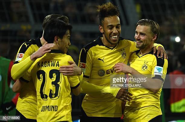 Dortmund's Gabonese striker PierreEmerick Aubameyang Dortmund's Japanese midfielder Shinji Kagawa and Dortmund's defender Marcel Schmelzer celebrate...