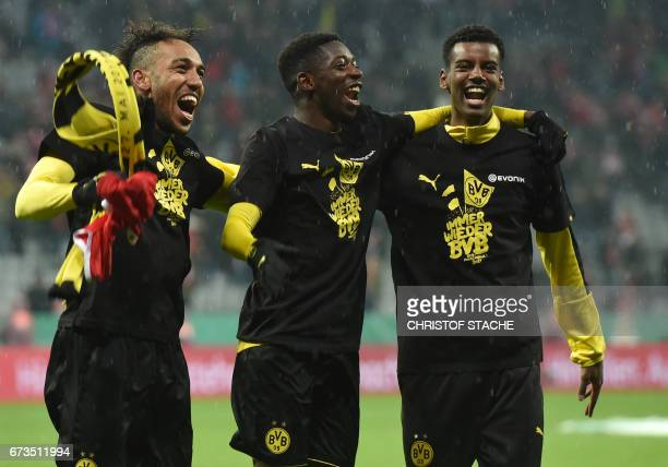 Dortmund's Gabonese striker PierreEmerick Aubameyang Dortmund's French midfielder Ousmane Dembele and Dortmund's Swedish striker Alexander Isak...