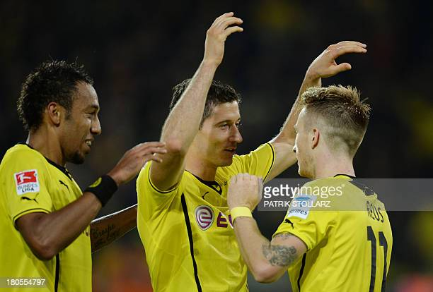 Dortmund's Gabonese striker PierreEmerick Aubameyang Dortmund's striker Marco Reus and Dortmund's Polish striker Robert Lewandowski celebrate scoring...