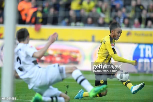 Dortmund's Gabonese striker PierreEmerick Aubameyang scores during the German first division Bundesliga football match Borussia Moenchengladbach v...