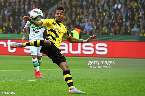 Dortmund's Gabonese striker PierreEmerick Aubameyang shoots to score during the German Cup DFB Pokal final football match between BVB Borussia...