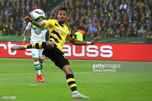 Dortmund's Gabonese striker PierreEmerick Aubameyang shoots to score during the German Cup DFB Pokal final football match between BVB Borussia...