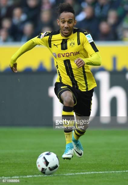 Dortmund's Gabonese striker PierreEmerick Aubameyang vies for the ball during the German first division Bundesliga football match of Borussia...