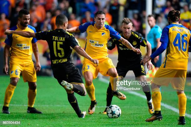 Dortmund's German defender Jeremy Toljan attempts to clear the ball during the UEFA Champions League football match between Apoel FC and Borussia...