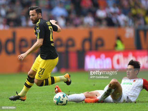 Dortmund's German midfielder Gonzalo Castro and Augsburg's South Korean midfielder Koo Jacheol vie for the ball during the German first division...