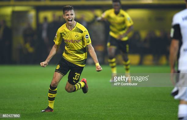 Dortmund's German midfielder Julian Weigl celebrates scoring during the German First division Bundesliga football match Borussia Dortmund vs Borussia...