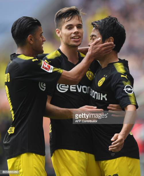 Dortmund's German midfielder Mahmoud Dahoud Dortmund's German midfielder Julian Weigl and Dortmund's Japanese midfielder Shinji Kagawa celebrate...