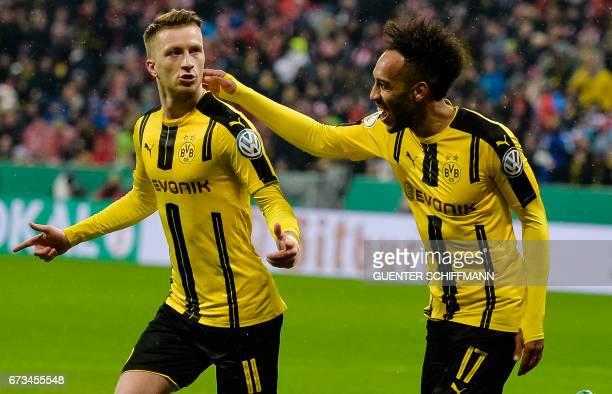 Dortmund's German striker Marco Reus celebrates his goal during the German Cup DFB Pokal semifinal football match between FC Bayern Munich and BVB...