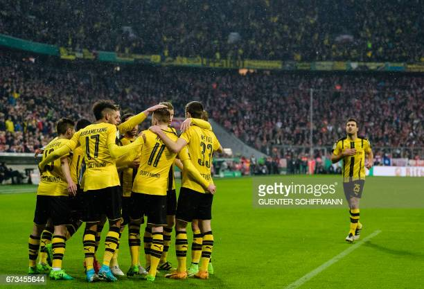 Dortmund's German striker Marco Reus celebrates his goal with teammates during the German Cup DFB Pokal semifinal football match between FC Bayern...