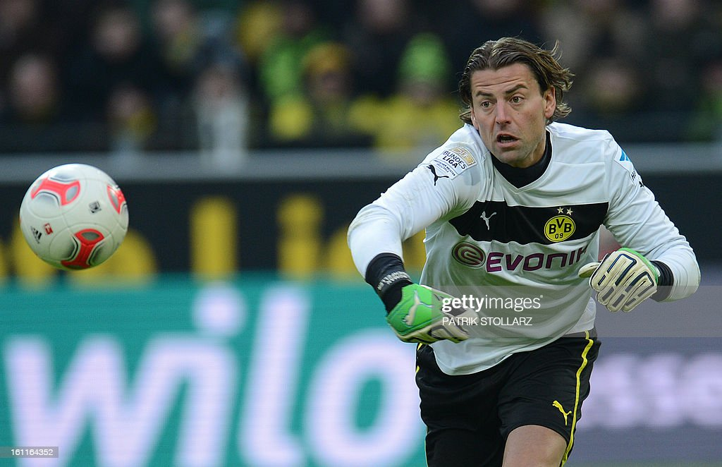 Dortmund's goalkeeper Roman Weidenfeller plays the ball during the German first division Bundesliga football match Borussia Dortmund vs Hamburger SV in Dortmund, western Germany, on February 9, 2013. Hamburg won 1-4.