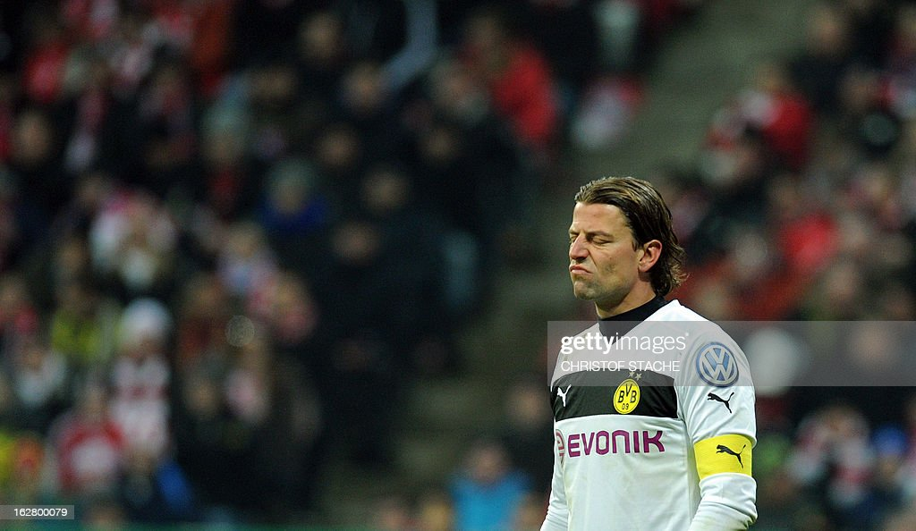 Dortmund's goalkeeper Roman Weidenfeller reacts during the German Cup quarter-final football match FC Bayern Munich vs Borussia Dortmund in Munich, southern Germany, on February 27, 2013. AFP PHOTO / CHRISTOF STACHE DURING THE MATCH AND PROHIBITS MOBILE (MMS) USE