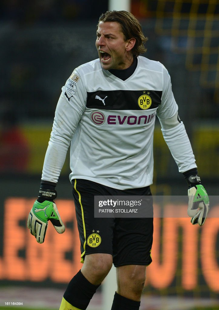 Dortmund's goalkeeper Roman Weidenfeller reacts during the German first division Bundesliga football match Borussia Dortmund vs Hamburger SV in Dortmund, western Germany, on February 9, 2013. Hamburg won 1-4.