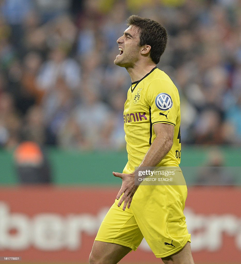 Dortmund's Greece defender Sokratis reacts during the second round football match of the German Cup (DFB - Pokal) TSV 1860 Munich vs Borussia Dortmund on September 24, 2013 in Munich, southern Germany. STACHE