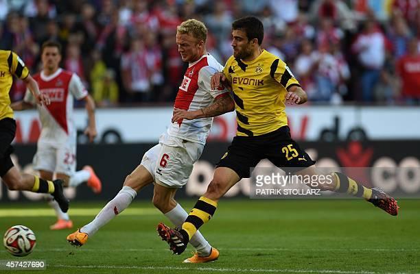 Dortmund's Greek defender Sokratis and Cologne's midfielder Kevin Vogt vie for the ball during the German First division Bundesliga football match 1...