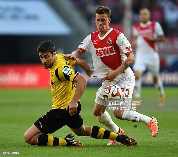 Dortmund's Greek defender Sokratis and Cologne's striker Simon Zoller vie for the ball during the German First division Bundesliga football match 1...