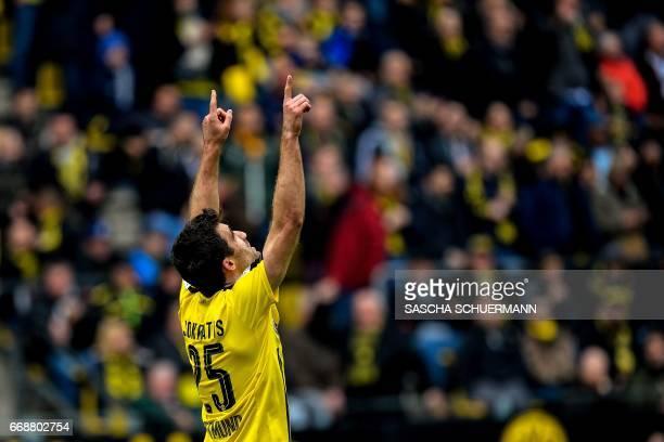 Dortmund's Greek defender Sokratis celebrates scoring the 21 during the German First division Bundesliga football match between Borussia Dortmund and...