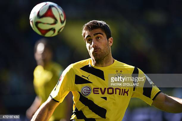 Dortmund's Greek defender Sokratis eyes the ball during the German first division Bundesliga football match Borussia Dortmund vs SC Paderborn in...