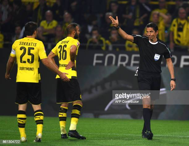 Dortmund's Greek defender Sokratis reacts after referee Deniz Aytekin shows him the red card during the German first division Bundesliga football...
