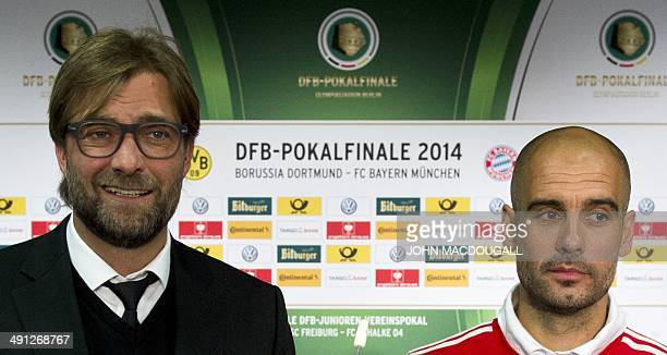 Dortmund's head coach Juergen Klopp and Bayern Munich's Spanish head coach Pep Guardiola pose with the German Cup following a press conference on the...