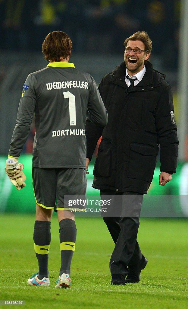 Dortmund's head coach Juergen Klopp (R) and Dortmund's goalkeeper Roman Weidenfeller celebrate after the UEFA Champions League last 16, second leg match Borussia Dortmund vs Shakhtar Donetsk in Dortmund, western Germany, on March 5, 2013. Dortmund won the match 3-0.