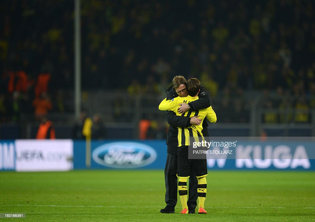 Dortmund's head coach Juergen Klopp (L) and Dortmund's midfielder Mario Goetze celebrate after the UEFA Champions League last 16, second leg match Borussia Dortmund vs Shakhtar Donetsk in Dortmund, western Germany, on March 5, 2013. Dortmund won the match 3-0.