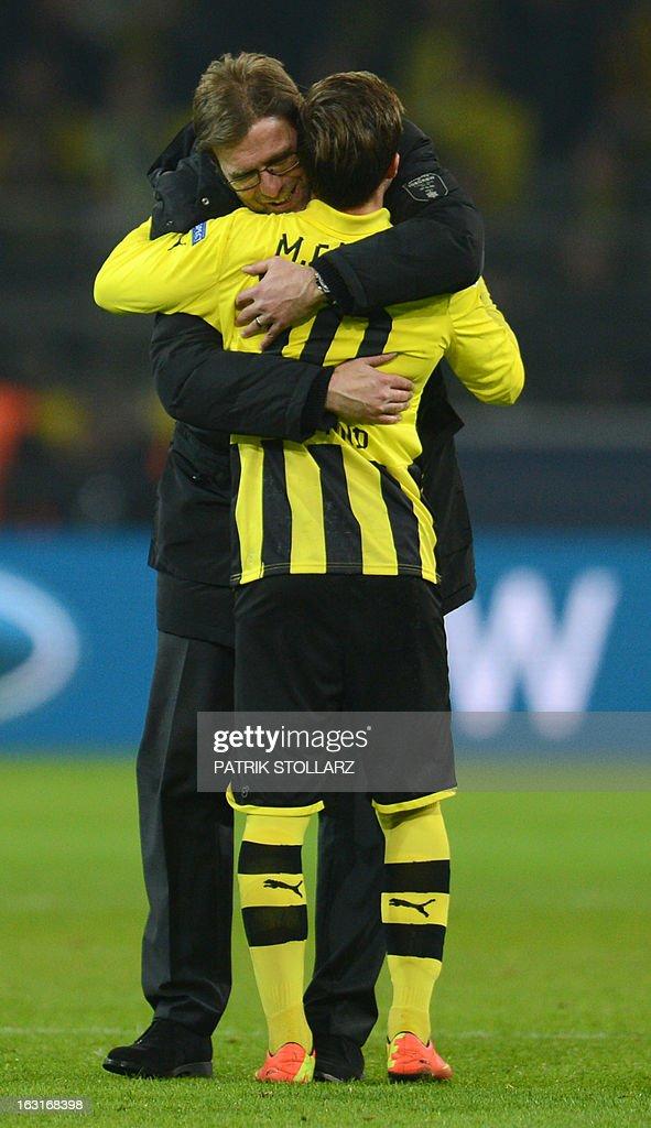 Dortmund's head coach Juergen Klopp (L) and Dortmund's midfielder Mario Goetze celebrate after the UEFA Champions League last 16, second leg match Borussia Dortmund vs Shakhtar Donetsk in Dortmund, western Germany, on March 5, 2013. Dortmund won the match 3-0. AFP PHOTO / PATRIK STOLLARZ