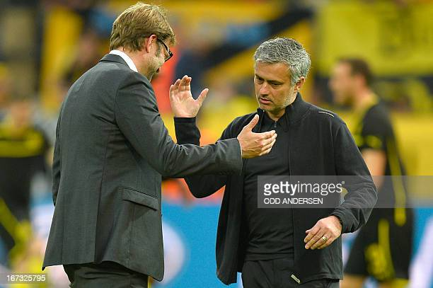 Dortmund's head coach Juergen Klopp and Real Madrid's Portuguese coach Jose Mourinho greet each other before the UEFA Champions League semi final...