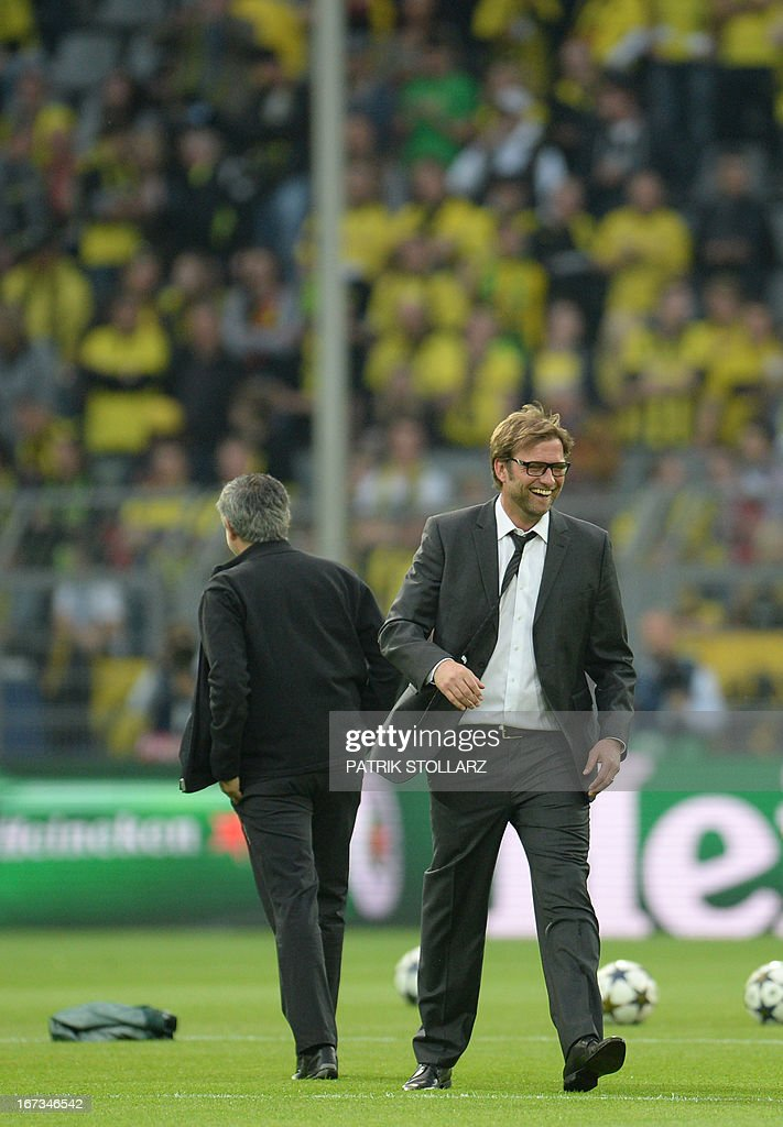 Dortmund's head coach Juergen Klopp (R) and Real Madrid's Portuguese coach Jose Mourinho stand on the pitch prior to the UEFA Champions League semi final first leg football match between Borussia Dortmund and Real Madrid on April 24, 2013 in Dortmund, western Germany. Dortmund won the match 4-1.
