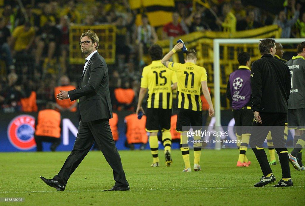 Dortmund's head coach Juergen Klopp (L) celebrates after the UEFA Champions League semi final first leg football match Borussia Dortmund vs Real Madrid on April 24, 2013 in Dortmund, western Germany.