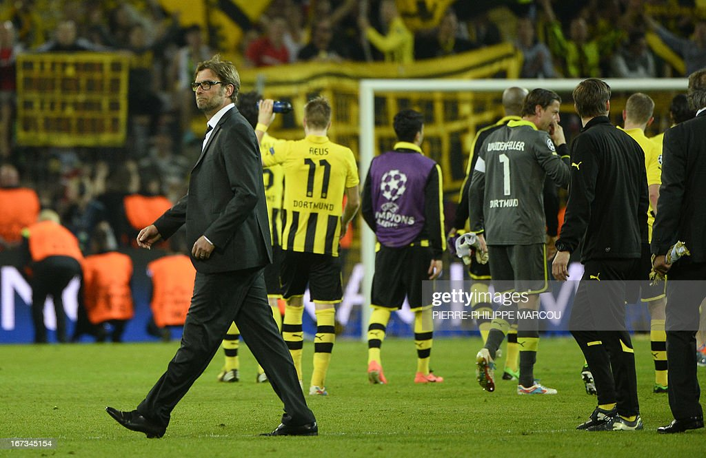 Dortmund's head coach Juergen Klopp (L) celebrates after the UEFA Champions League semi final first leg football match Borussia Dortmund vs Real Madrid on April 24, 2013 in Dortmund, western Germany.