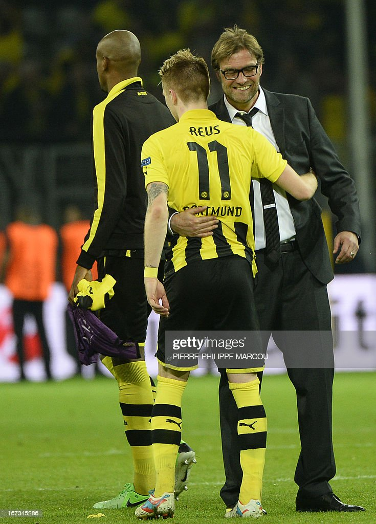 Dortmund's head coach Juergen Klopp (R) celebrates with Dortmund's striker Marco Reus after the UEFA Champions League semi final first leg football match Borussia Dortmund vs Real Madrid on April 24, 2013 in Dortmund, western Germany. Dortmund won the match 4-1.