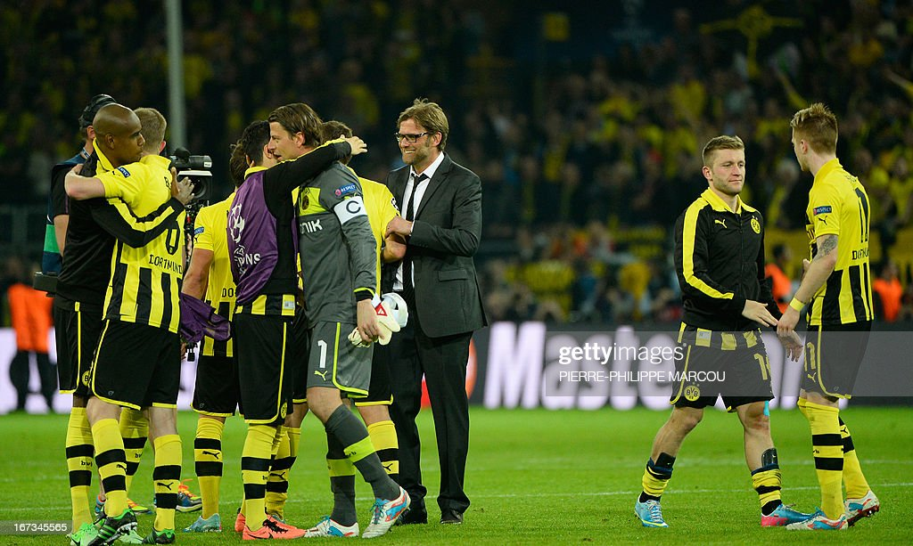 Dortmund's head coach Juergen Klopp (C) celebrates with his players after the UEFA Champions League semi final first leg football match Borussia Dortmund vs Real Madrid on April 24, 2013 in Dortmund, western Germany. Dortmund won the match 4-1.