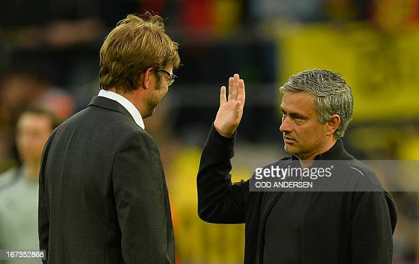 Dortmund's head coach Juergen Klopp chats with Real Madrid's Portuguese coach Jose Mourinho before the UEFA Champions League semi final first leg...