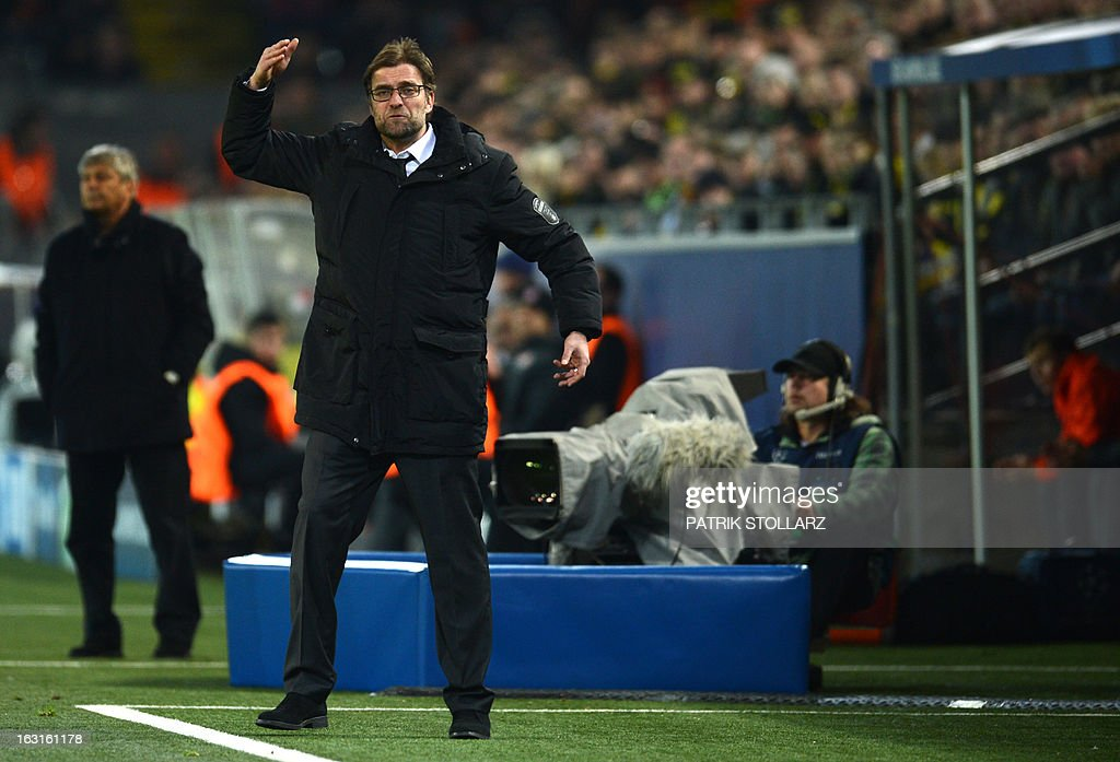 Dortmund's head coach Juergen Klopp gestures during the UEFA Champions League last 16, second leg match Borussia Dortmund vs Shakhtar Donetsk in Dortmund, western Germany, on March 5, 2013.