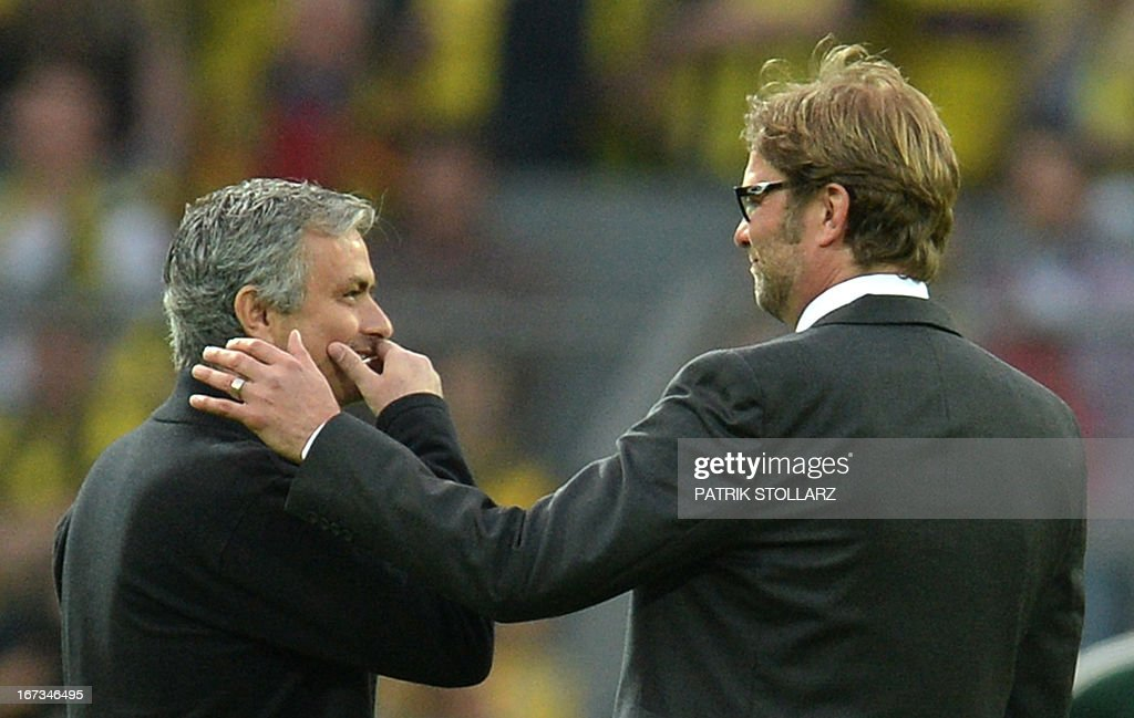 CROP - Dortmund's head coach Juergen Klopp (R) gestures towards Real Madrid's Portuguese coach Jose Mourinho prior to the UEFA Champions League semi final first leg football match between Borussia Dortmund and Real Madrid on April 24, 2013 in Dortmund, western Germany. Dortmund won the match 4-1.