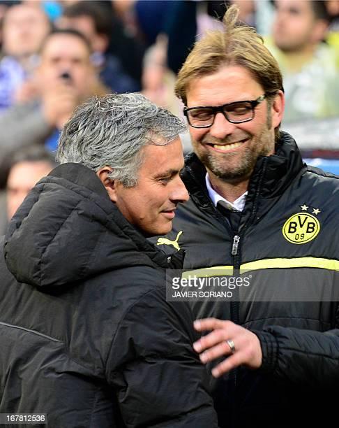 Dortmund's head coach Juergen Klopp greets Real Madrid's Portuguese coach Jose Mourinho before the UEFA Champions League semifinal second leg...