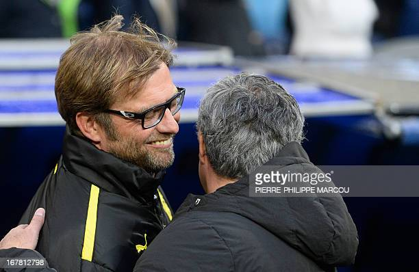 Dortmund's head coach Juergen Klopp greets Real Madrid's Portuguese coach Jose Mourinho during the UEFA Champions League semifinal second leg...