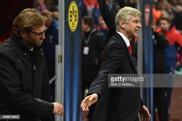 Dortmund's head coach Juergen Klopp is greeted by Arsenal's French manager Arsene Wenger before the UEFA Champions League Group D football match...