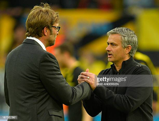 Dortmund's head coach Juergen Klopp is greeted by Real Madrid's Portuguese coach Jose Mourinho before the UEFA Champions League semi final first leg...