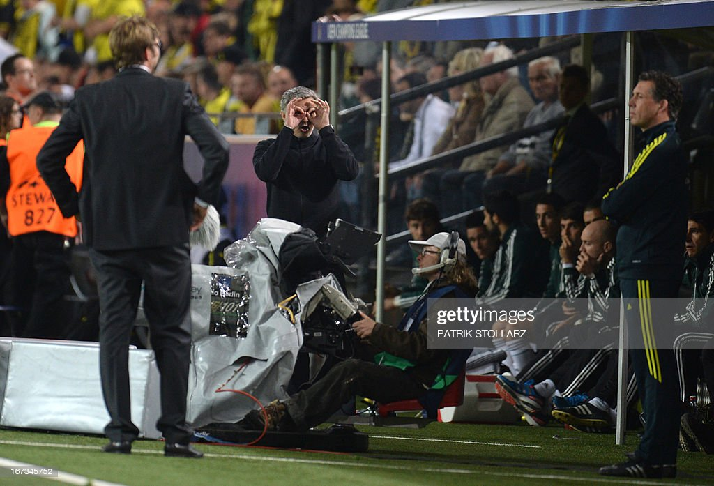 Dortmund's head coach Juergen Klopp (L) looks on as Real Madrid's Portuguese coach Jose Mourinho (2nd L) gestures during the UEFA Champions League semi final first leg football match between Borussia Dortmund and Real Madrid on April 24, 2013 in Dortmund, western Germany. Dortmund won the match 4-1.